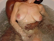 Beautiful Housewife in Bathtub with Black Man