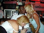 Two White Women Sucking Black Man in a Bar