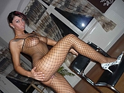 Sexy German pussy posing nude in fishnet