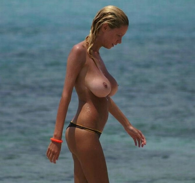Naked women with huge tits on beach