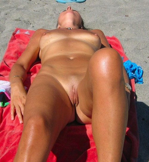 Nudist Woman with Shaved Pussy at the Beach