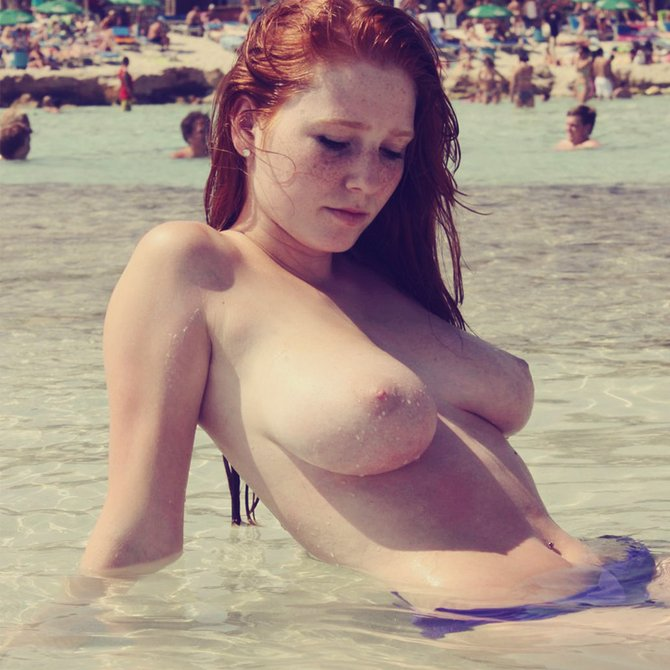 Redhead Girl Topless at Beach