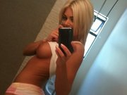 Hot Blonde with Big Ass Poses Topless