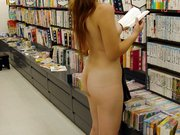 Woman Flashes Nude in Public Library