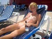 Blonde Nudist Woman Doing Sunbath
