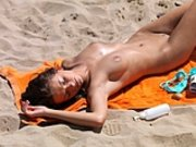 Nudist Girl Doing Sunbath at Beach