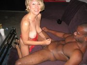 Blonde Wife Performs Handjob to Black Man